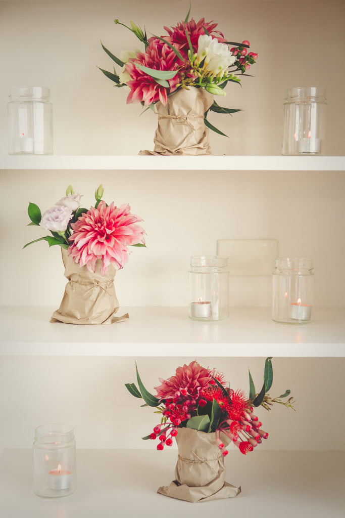 Jars of flowers scattered around the wedding venue