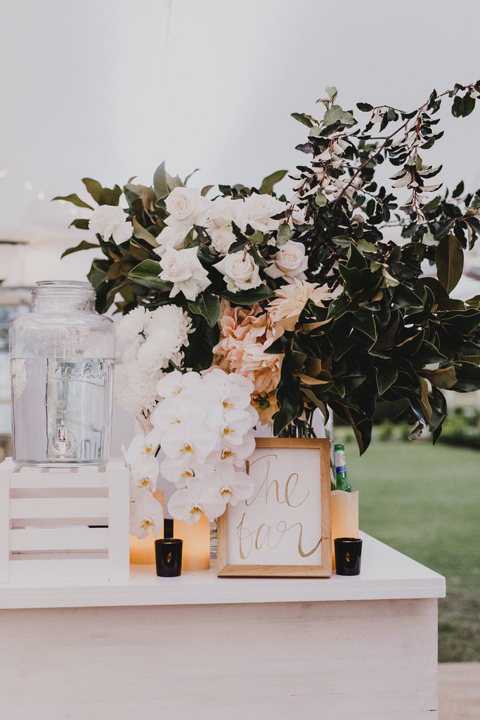 Statement bar flowers wedding reception