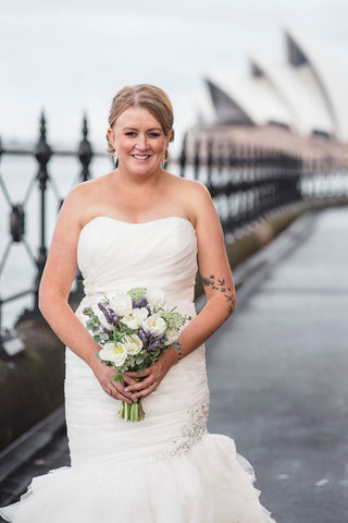 The Bride poses for a photo outside the Sydney Opera House.