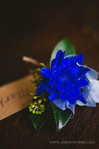 Vibrant blue male buttonhole for the Groom.