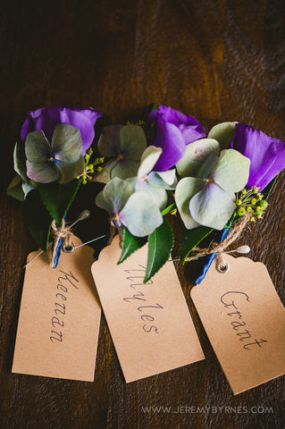 Purple male buttonholes for the Groomsmen.