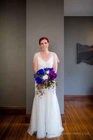 Bride holding her vibrant colourful bouquet.