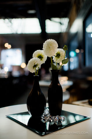 Pompom dahlia in black vases made simple stylish table centres.