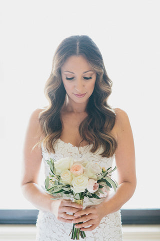 Bride Michelle with her bouquet of soft roses and olive foliage.