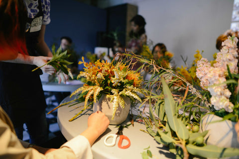 Students working on their flower arrangements