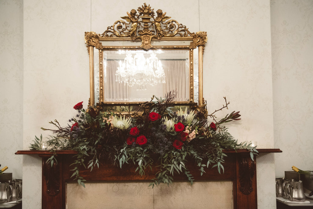 Fireplace mantle floral installation