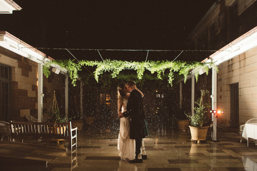 Bride and Groom in courtyard at Gunners Barracks