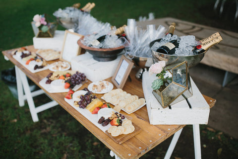 Beautifully styled food and drinks table at wedding ceremony