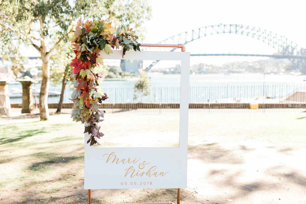 Wedding ceremony florals on Bennelong Lawn