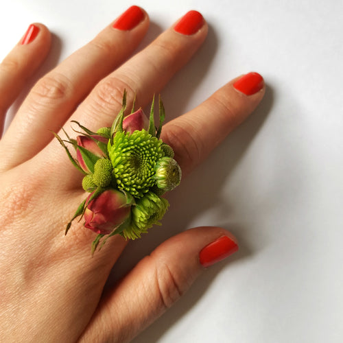 Fresh flower ring in green and pink.