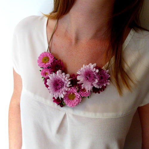 Fresh floral necklace in pinks and purples.