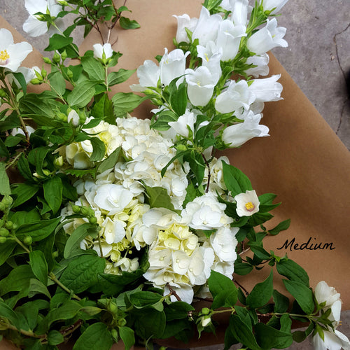 Bouquet in white and green seasonal florals