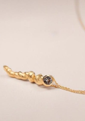 'Enriched from any repetition' Pendant, 18 kt Fairtrade gold, grey spinel