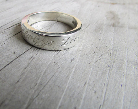 Engraved tapered ring