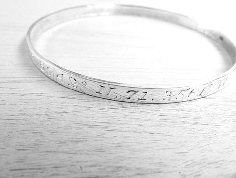 Bangle engraved with GPS coordinates