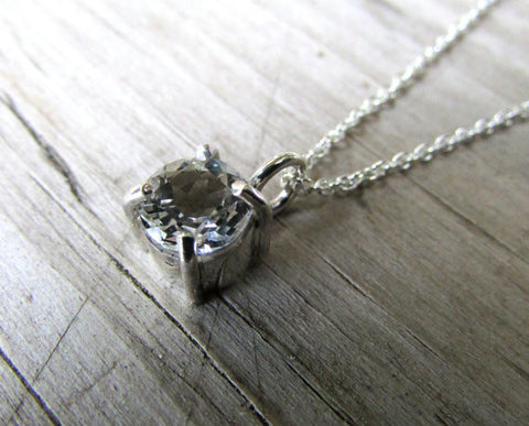 white topaz claw set pendant