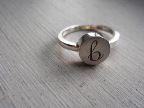 Engraved initial ring