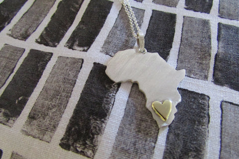 Africa necklace with heart in brass or copper