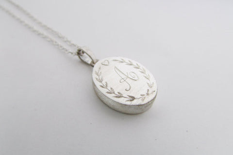 Engraved locket style necklace oval pendant with personalized engraving