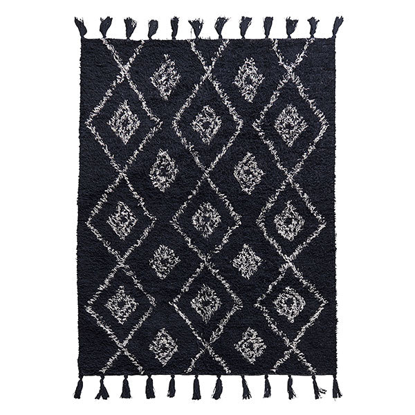 Monochrome berber style rug with tassel edge