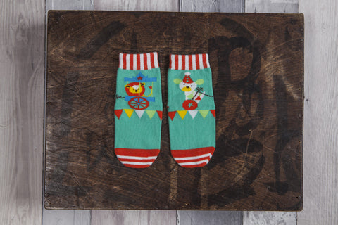 Left to right storytelling design, circus themed socks for boys' and girls'.