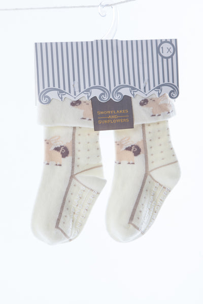 Single pair of Snowflakes and sunflowers turnover top boys' and girls' socks.