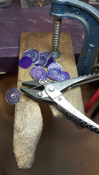 Purple aluminium scrolls on bench peg