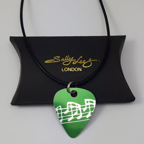 Green guitar pick pendant  with musical notes pattern hand made by Sally Lees