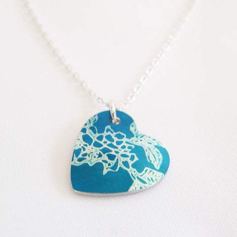 Hand made aluminum blue carnations birth flower heart pendant ith siver chain by Sally Lees