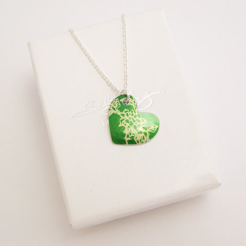 hand made aluminum green carnations birth flower hear pendant with silver chain by Sally Lees
