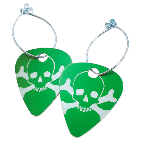 Green guitar pick earrings printed with skulls
