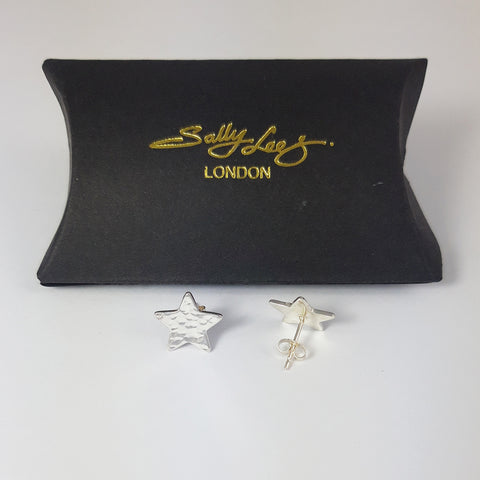 Sterling silver star stud earrings by Sally Lees photographed with a black pillow shaped gift box
