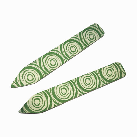Women's suffrage collar stiffeners in green with silvery patterns of scrolls down the length of each collar stiffener.