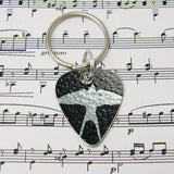 hand made aluminum Black swallows guitar pick keyring by Sally Lees
