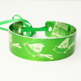 The bird has flown green aluminium cuff