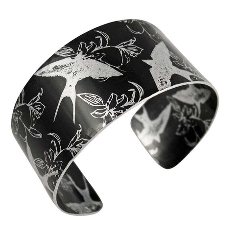 black aluminium hand made cuff with swallows and iris prints