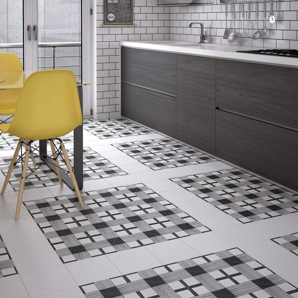 Unusual black and white pattern effect kitchen floor tiles