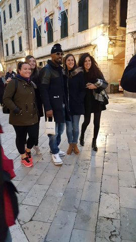 Jamie Foxx on Stradun, Dubrovnik - holding the Break Time bag full of nautical souvenirs, including anchor bracelets