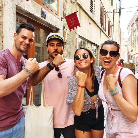 Happy tourists in Split, Croatia with their handmade souvenirs from Break Time nautical jewelry