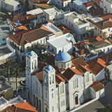 Andros book open to show a church from the air