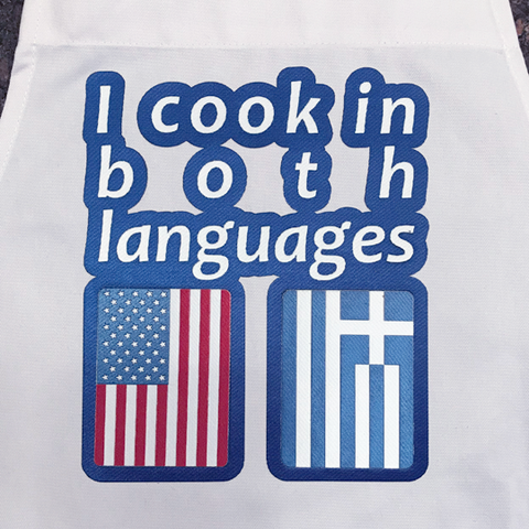 'I cook in two languages' Greek Apron