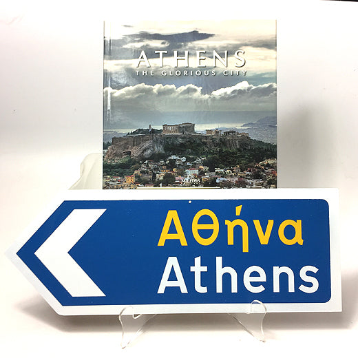 Greek Road Sign pointing to the Left with Athens book