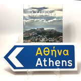 Athens Greek Road Sign with an arrow pointing the left with the Athens book.