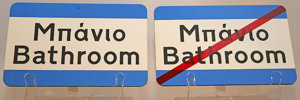 Bath room signs made by the pair