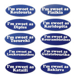 Ten lapel pins with ten different Greek pasties stating how 'sweet' each one is.