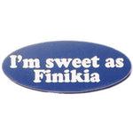 'I'm sweet as Finikia' is engraved onto a blue oval lapel pin.