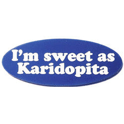 """I'm sweet as Karidoptia"", blue plastic engraved lapel pin."