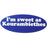 """I'm sweet as Kaourambiethes"", lapel pin with this phrase engraved onto blue plastic."