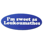 Oval lapel pin etched to read, 'I'm sweet as Loukoumathes'.