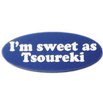 """I'm sweet as Tsoureki"", words engraved with white letters on blue background made into a lapel pin."